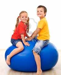 Kids using a ball for exercise