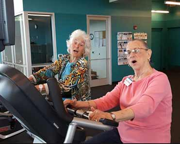 Two Senior Women exercising which is good for their brain