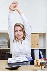 Woman exercising at her desk