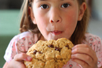 A girl eating a cookie