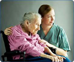 Caregiver taking good care of an elderly patient