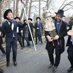 Rabbi with a Torah with others celebrating