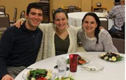 3 students eating at Hillel