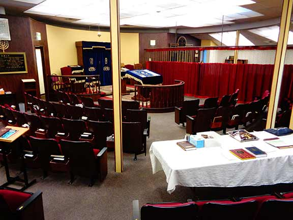 Inside shul separate men's section & separate women's section with a Mechitza inbetween