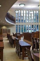 Sanctuary showing the mechitza (separate seating for women) at Ohr HaTorah in North Dallas