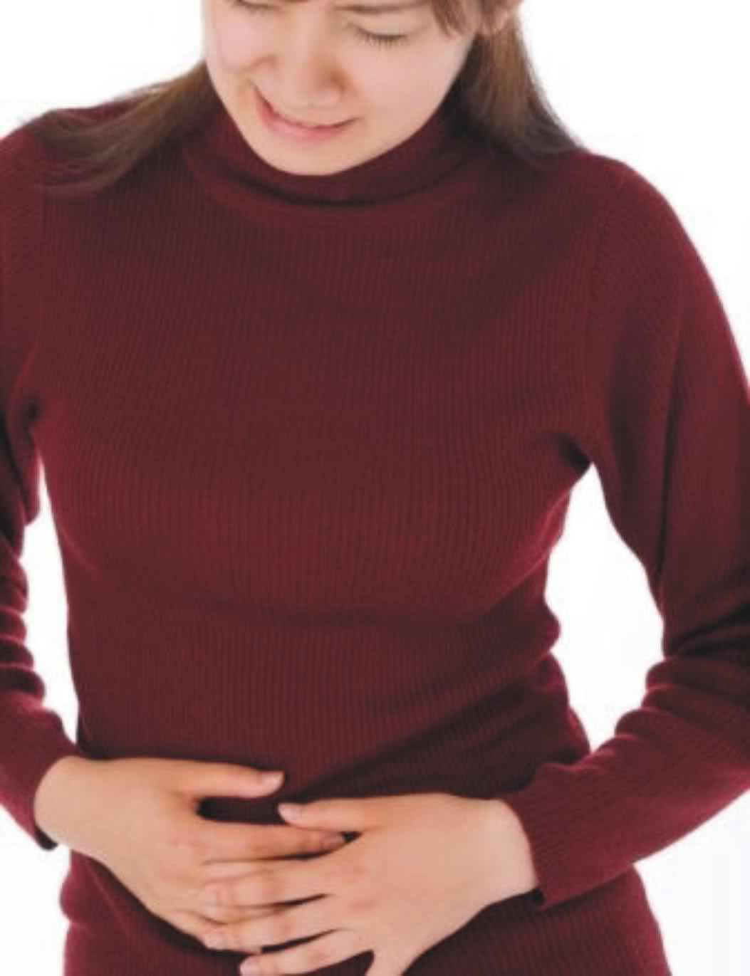 Woman with stomach pain from Celiac Disease