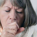 A woman with silent acid reflux coughing