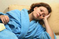 Woman with jet lag that can't fall asleep