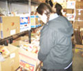 A teenage girl volunteering to help Tomchei Shabbas distribute food to the needy